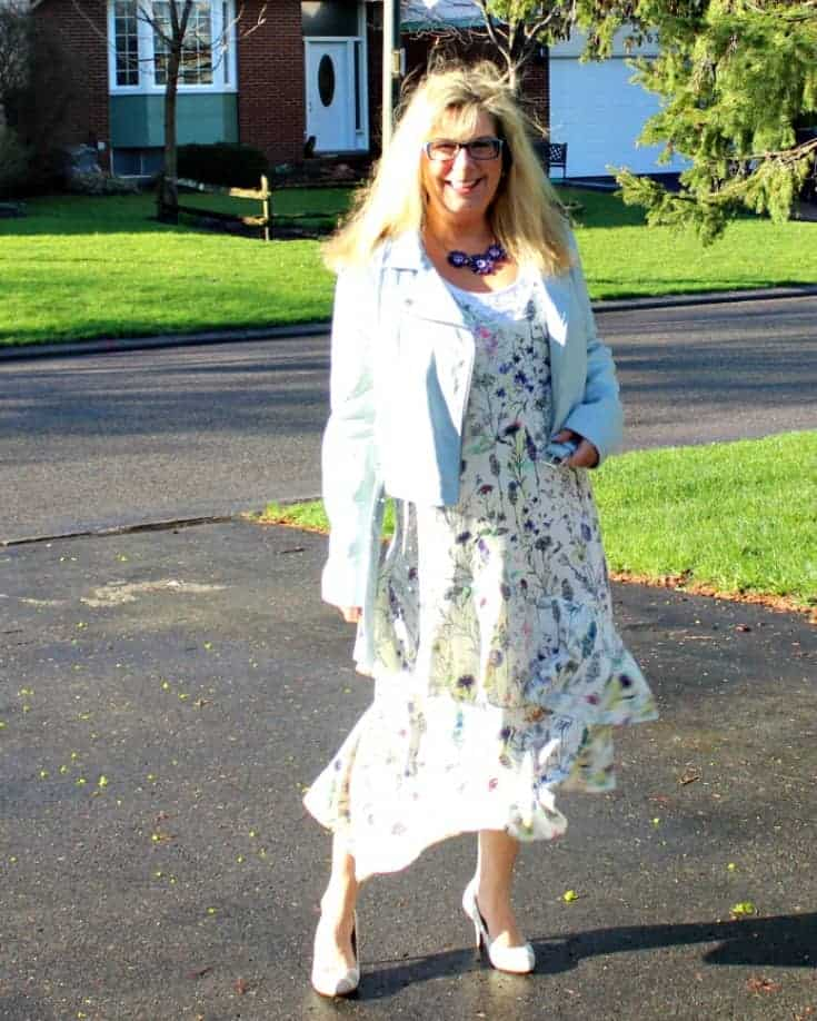 strolling in h&M floral dress with striped shoe dazzle pumps and a moto jacket