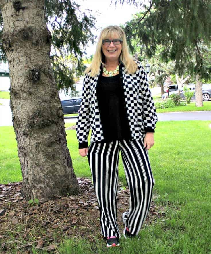 Checkes and Stripes in a flowy outfit with Neon Nike sneakers and a fun yosa necklace 5