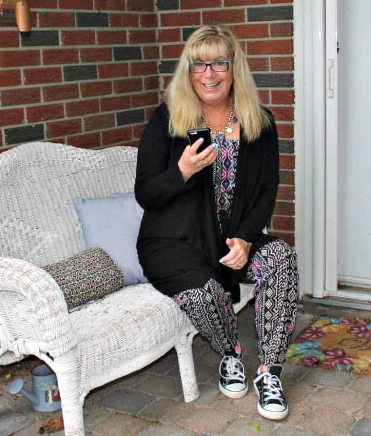 sharing social media in A Tribal jumpsuit, lace cardigan and black converse 9