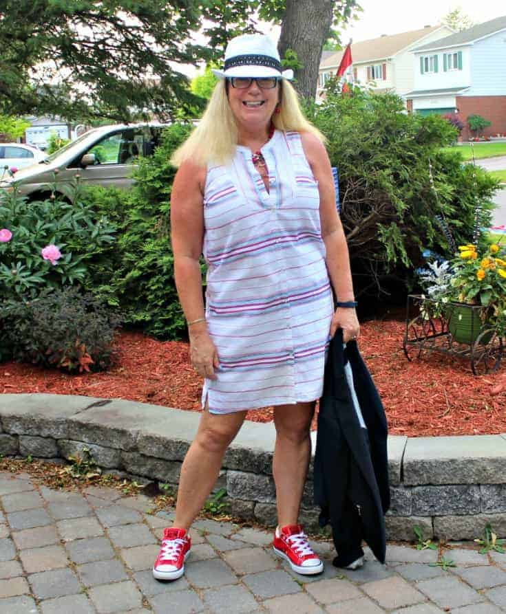 Red converse and a striped dress from Old Navy with a fedora from Carnival