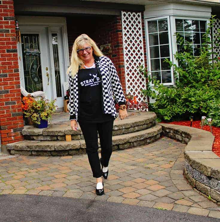 strolling in slim pants from Vanheusen with a houndstooth top and a Beer tank with circus by Sam edelman loafers
