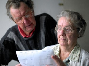 older couple looking at investments