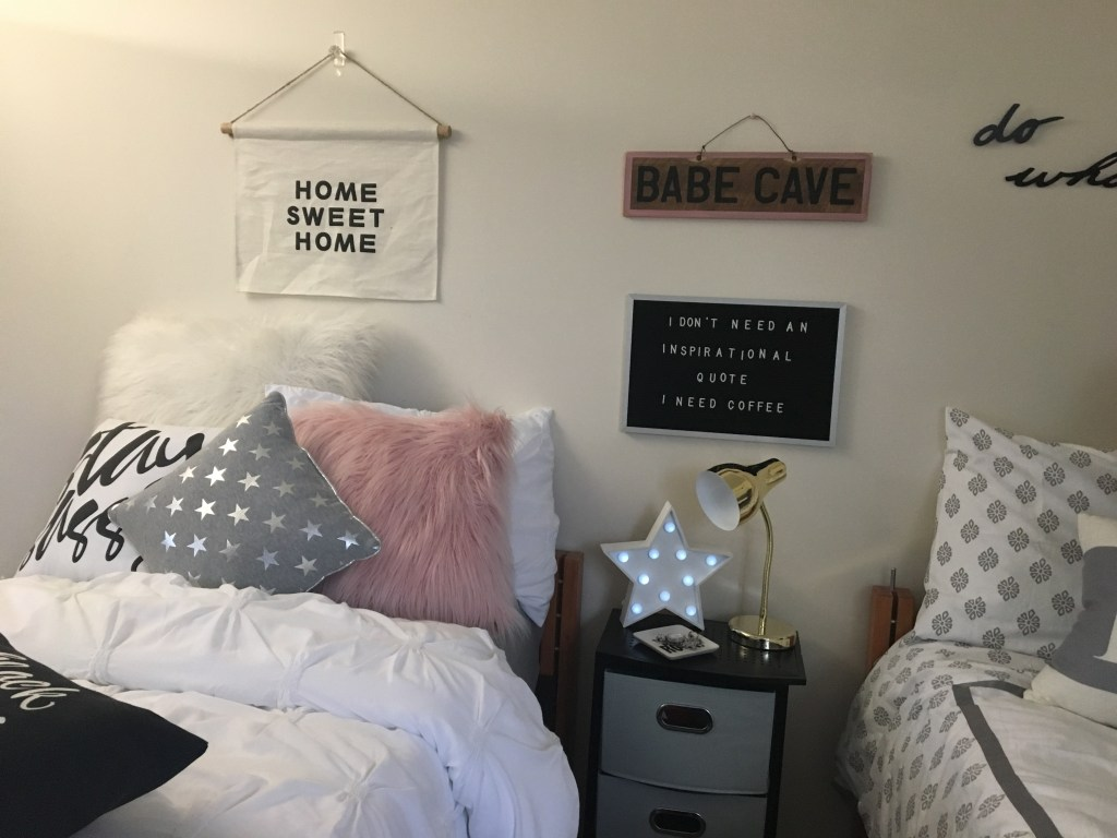 pink and grey decorated dorm room