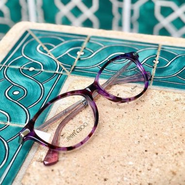 Jimmy Choo eyeglasses on a table.