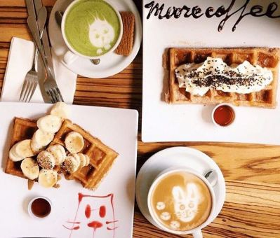 A photo of a breakfast of coffee and waffles