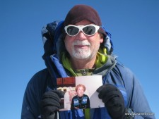 Alan holding a picture of Ida Arnette on the summit of Mt. Elbrus