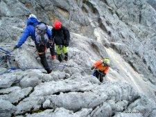 Team Rapelling Down From Summit Ridge