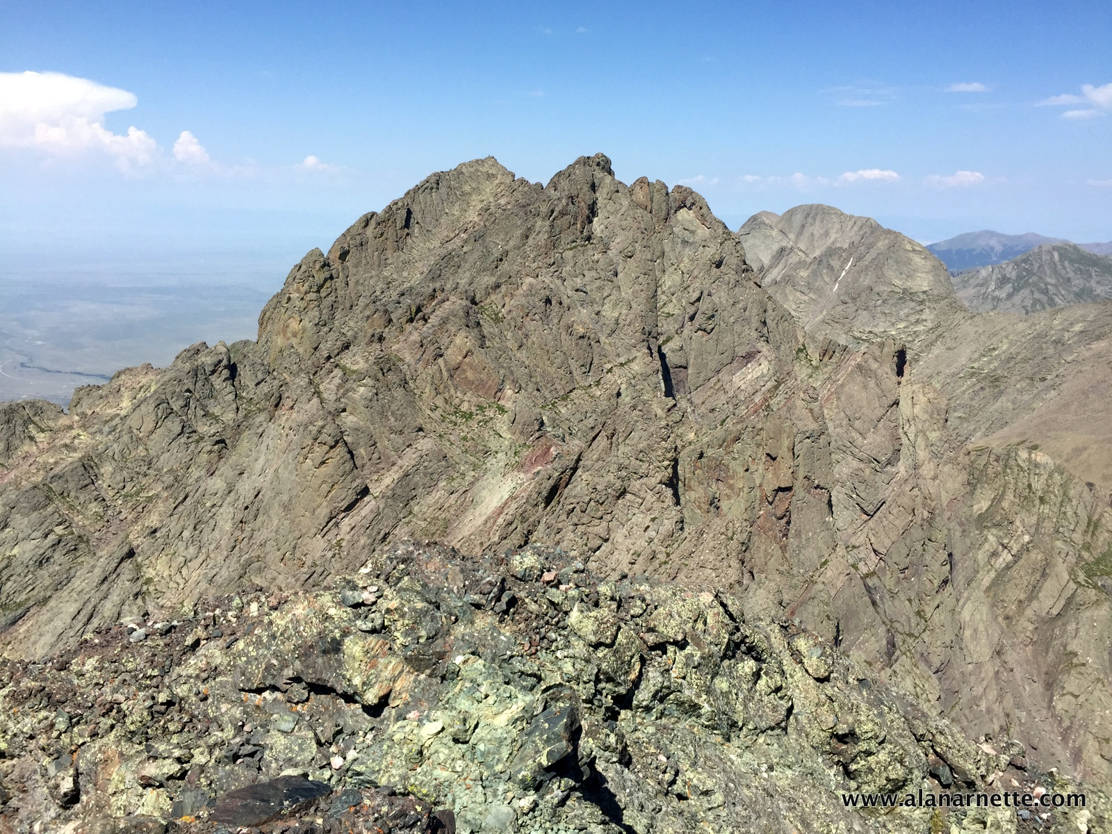 Looking back at Crestone Peak from Crestone Needle. You can see climbers on the summit.