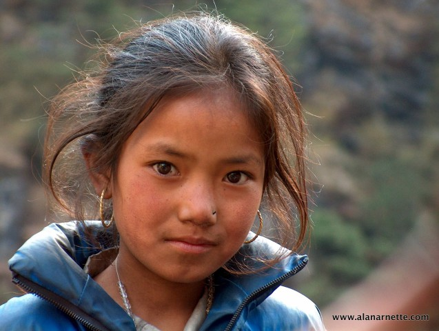 One of my all time favorite pictures from Nepal in 2002. I met this young lady and her brothers and sisters just above Namche Bazar. She looked directly into the camera, almost posing, for this shot. I wonder where she is today?