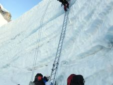 Climbing one of the last ladders in the Khumbu Icefall in 2015.