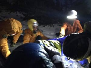 NPS Rangers working on Alan at Twin Sisters