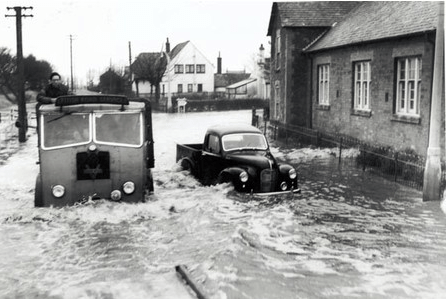 Vehicles negotiate the 1953 floods in Mablethorpe.
