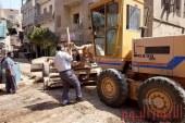 بالصور حمله مكبره بمدينه الفشن جنوب بنى سويف لازاله المطبات وتسويه الشوارع