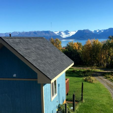 View of cabin and view out front in late summer