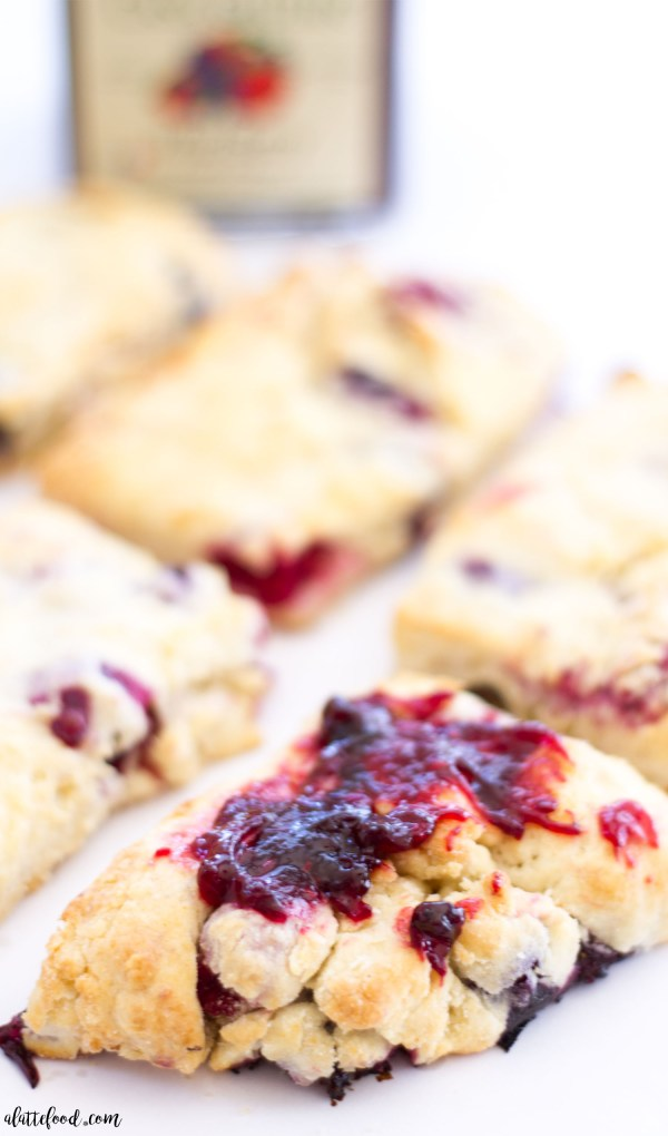 These homemade berry biscuits are buttery, flaky, and perfect when slathered with sweet jam! These mixed berry biscuits are filled with fresh blueberries and raspberries, and they have a hint of lemon flavor that adds a bright and fresh flavor to these homemade biscuits!