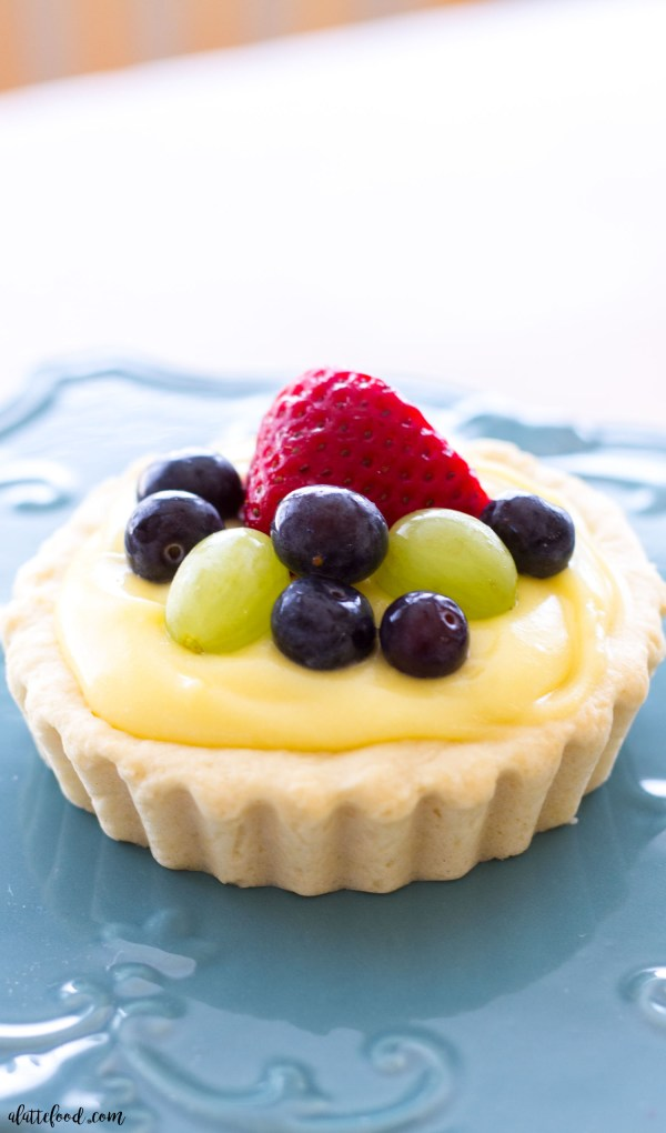 These easy Sugar Cookie Fruit Tarts have a sugar cookie crust, creamy lemon filling, and topped with fresh, seasonal fruit! These fruit tarts are a fun and surprisingly simple spring or summer dessert!