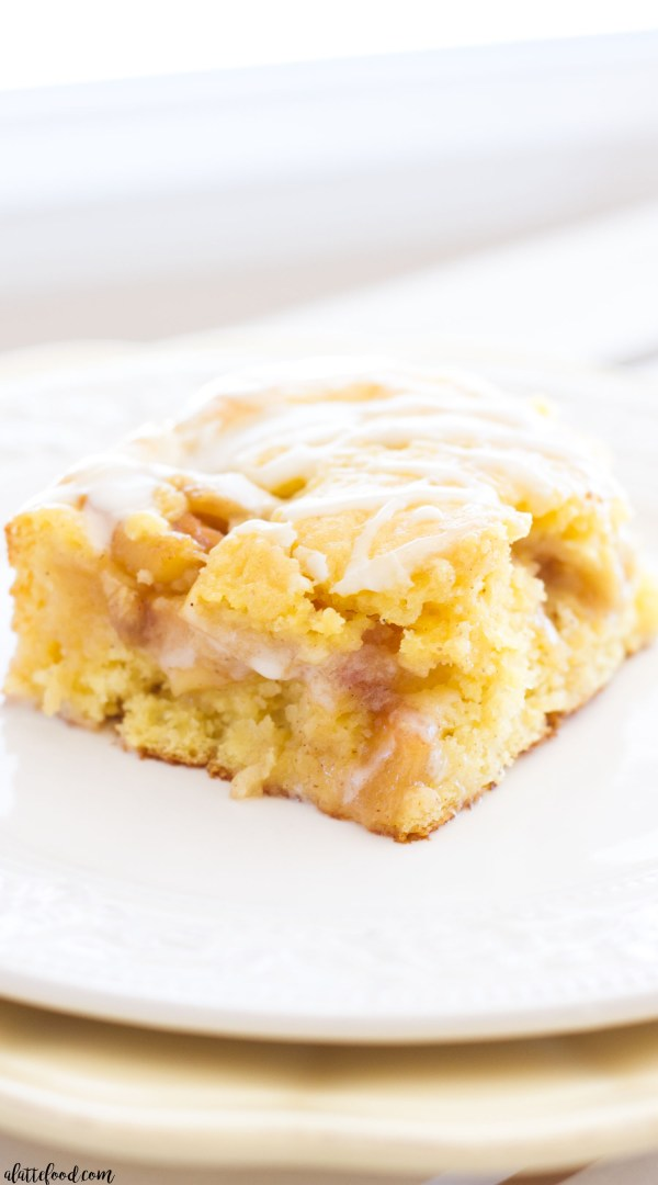 This easy Apple Pie Coffee Cake starts with boxed cake mix and ends with homemade apple pie filling and a sweet vanilla glaze! This coffee cake recipe is so easy, but it tastes like a million bucks! The perfect breakfast, brunch, or dessert recipe!