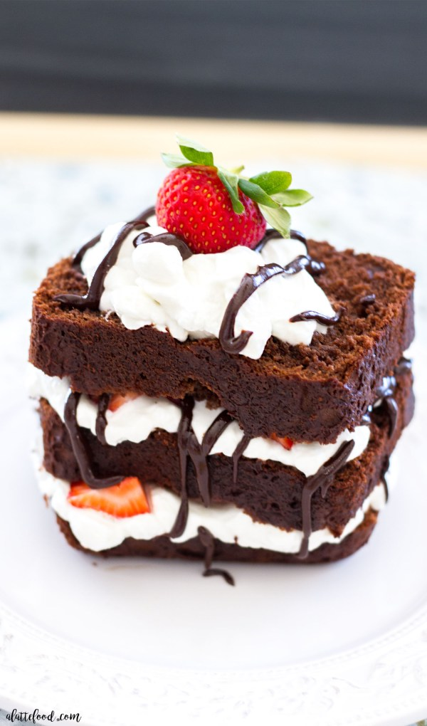 This chocolate espresso pound cake is rich, decadent, and absolutely chocolatey! With homemade whipped cream, fresh strawberries, and chocolate ganache, this chocolate pound cake recipe might be your new favorite dessert!