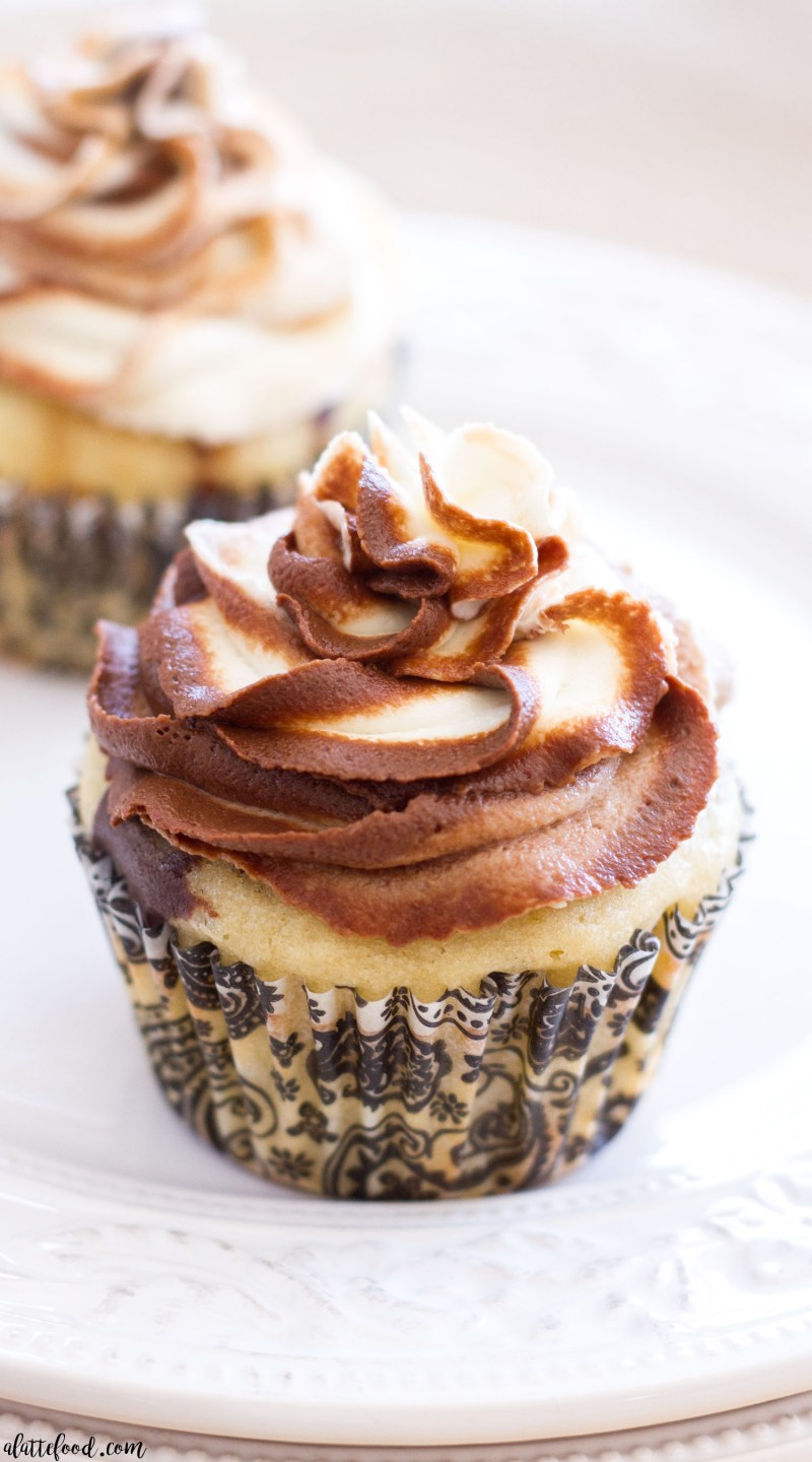 Homemade chocolate cake and homemade vanilla cake are swirled together to create a gorgeous Chocolate Vanilla Marble Cupcake recipe! Homemade chocolate buttercream and homemade vanilla buttercream are swirled together to make a beautiful marble buttercream! These marble cupcakes are so simple and so easy!