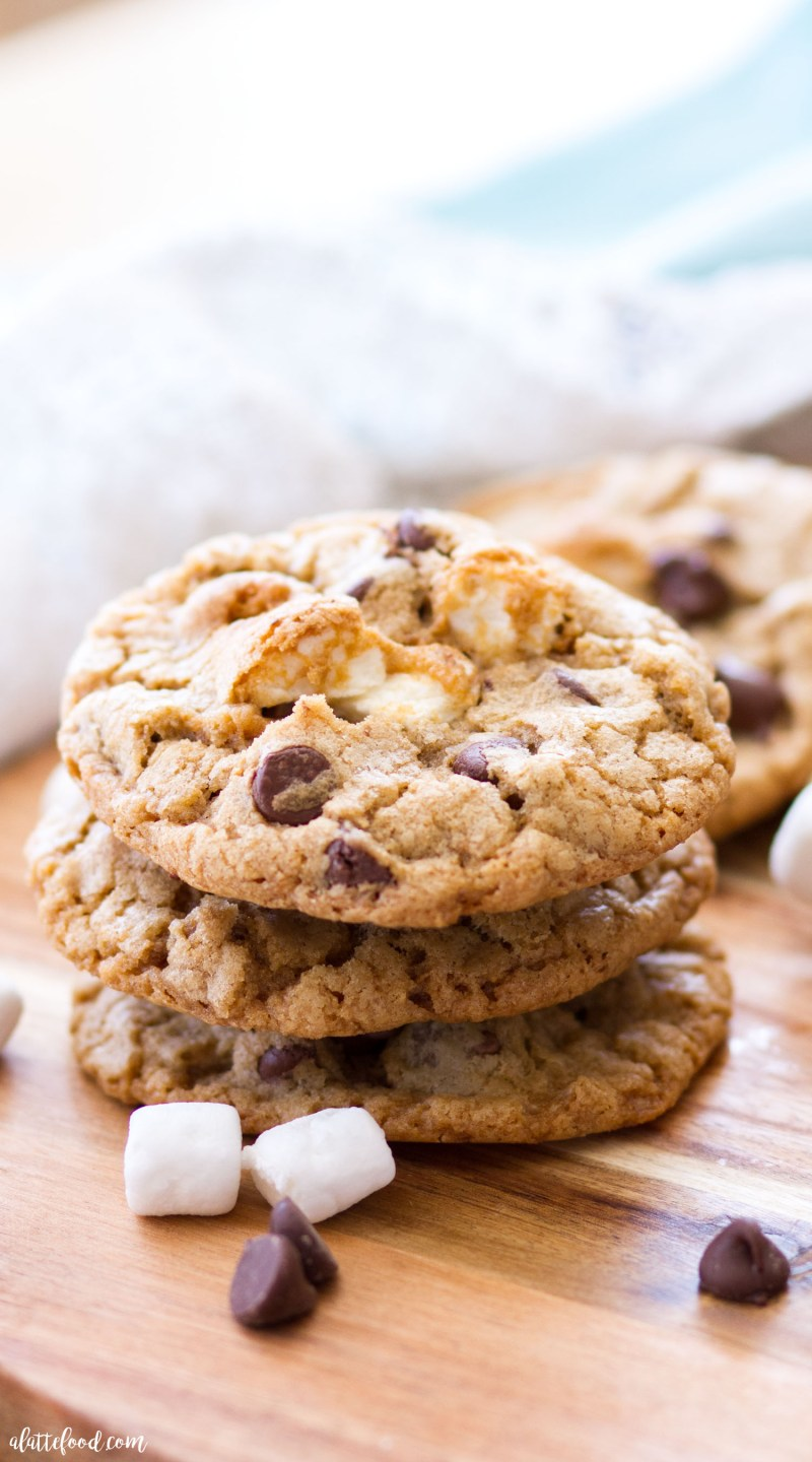 These rich S'more Chocolate Chip Cookies are filled with gooey marshmallows, crushed graham crackers, and plenty of chocolate chips! The classic chocolate chip cookie recipe has never tasted better than with the addition of s'more ingredients! Your life will never be the same. s'mores, best chocolate chip cookie recipe, easy summer desserts