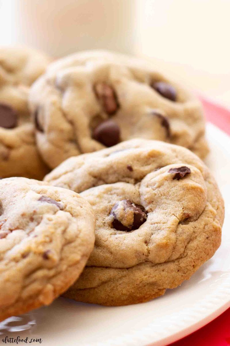 gooey dark chocolate chip toffee cookie baked on a white plate