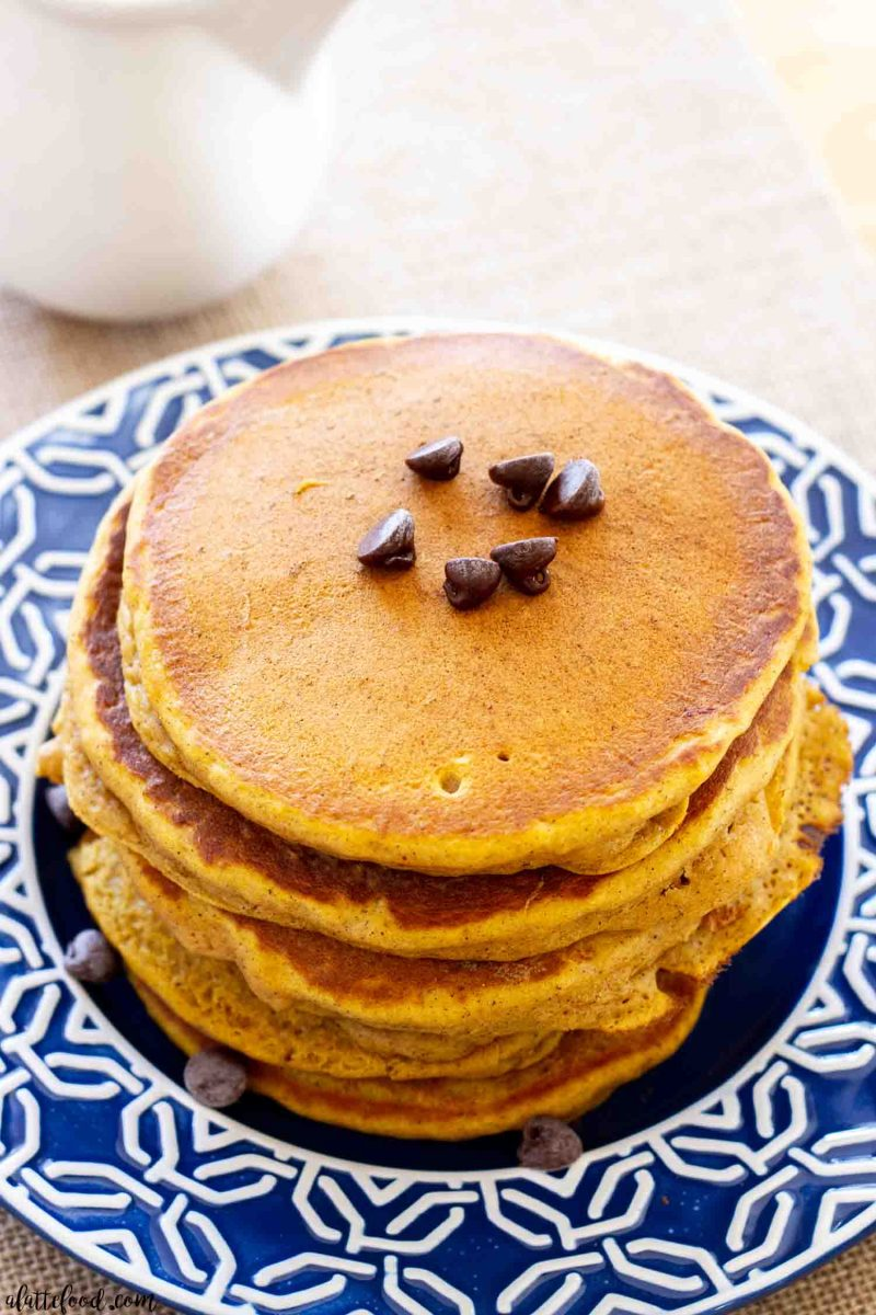 stack of pumpkin chocolate chip pancakes on blue plate