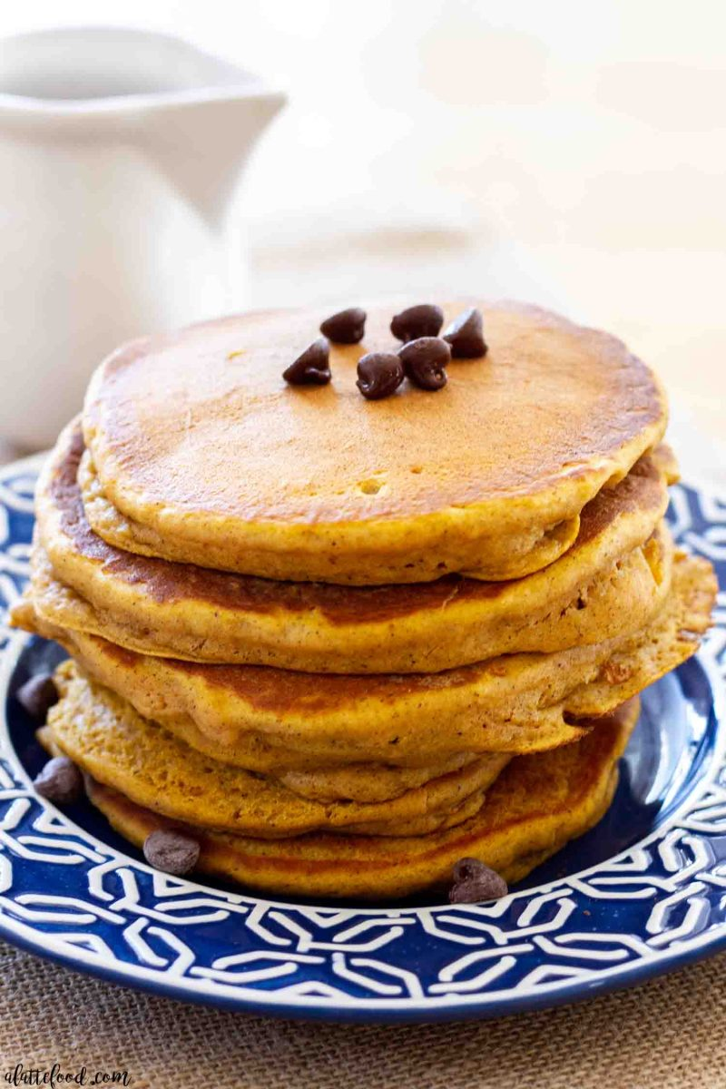 pumpkin pancakes with chocolate chips on flowered blue and white plate