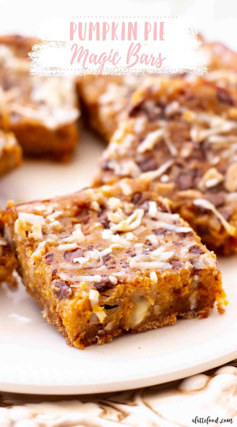 pumpkin pie dream bars with coconut and chocolate chips on white plate