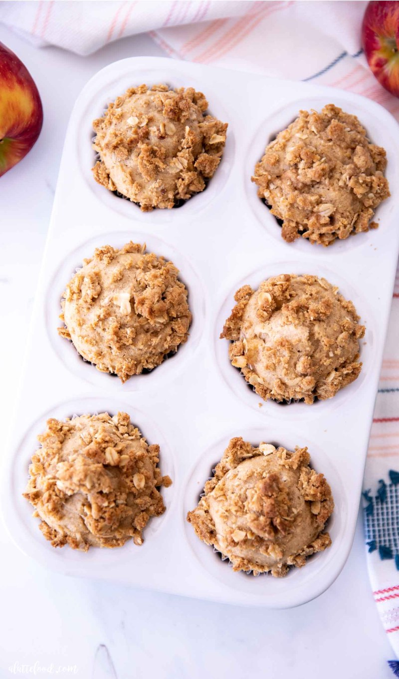 crumb cake topped muffins with apples and cinnamon