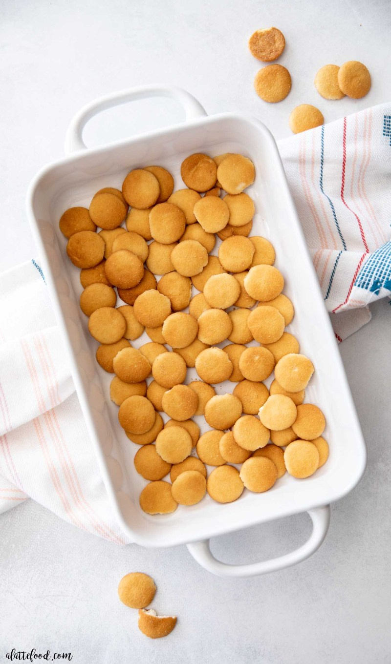 vanilla wafer cookies in a white baking dish on a gray board