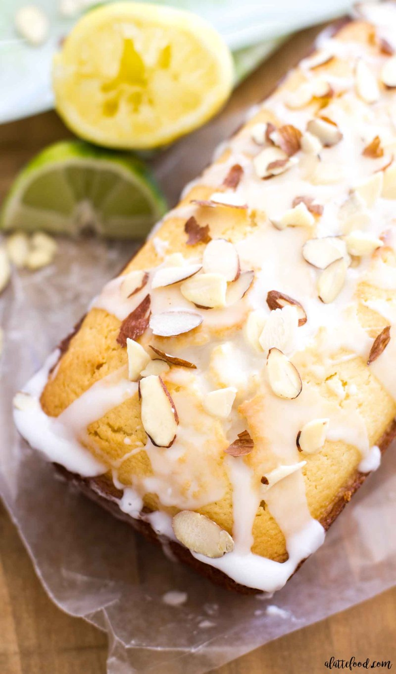 This Citrus Almond Loaf Cake is a play on Starbucks lemon loaf cake, but has a lemon-lime and almond twist. This homemade lime and lemon cake is made in a loaf pan and topped with a citrus almond glaze that is to die for! A perfect lemon dessert for spring or summer! the best lemon cake recipe, almond cake recipe