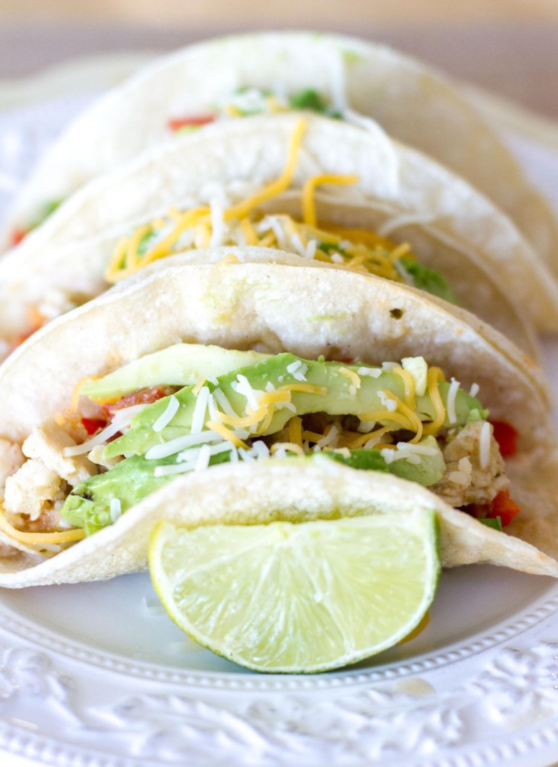 The crockpot does all the work when it comes to these easy Salsa Verde Honey Lime Chicken Tacos!  Plus, these slow cooker chicken tacos pack a punch in the flavor department! Don't worry, guys, I've got dinner covered.