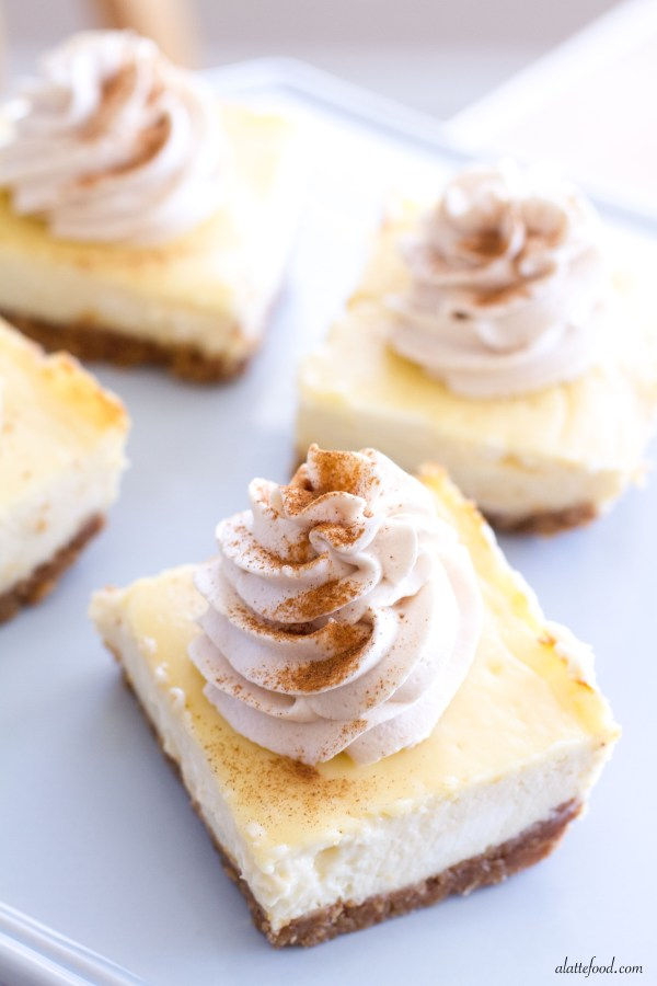 Vanilla Cheesecake Bars with Chai Whipped Cream | These creamy vanilla cheesecake bars are rich, delicious, and topped with a homemade chai whipped cream! | www.alattefood.com
