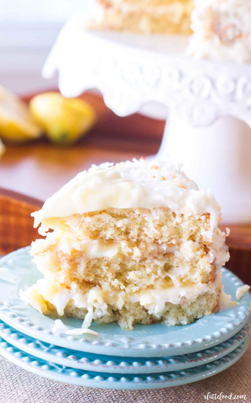 This homemade Lemon Coconut Cake has layers of homemade lemon curd and lemon cream cheese frosting. The classic coconut cake recipe is given a lemon twist, making it the perfect recipe for a stunning spring dessert or easy Easter dessert!