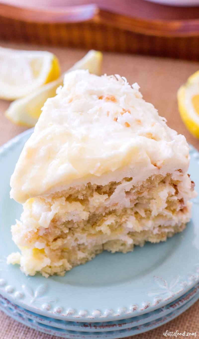 This homemade Lemon Coconut Cake has layers of homemade lemon curd and lemon cream cheese frosting. The classic coconut cake recipe is given a lemon twist, making it the perfect recipe for a stunning spring This homemade Lemon Coconut Cake has layers of homemade lemon curd and lemon cream cheese frosting. The classic coconut cake recipe is given a lemon twist, making it the perfect recipe for a stunning spring dessert or easy Easter dessert!