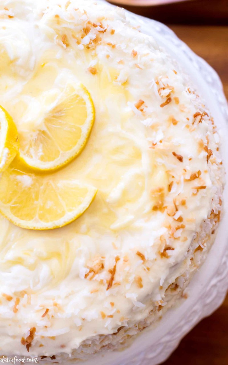 lemon coconut cake on white cake stand