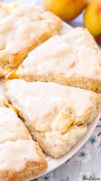 These easy Peach Pie Scones taste just like peach pie! Peaches 'n Cream Scones are the perfect summer breakfast or summer brunch recipe! With their sweet vanilla glaze, these peach cream scones taste like they have a scoop of vanilla ice cream on top! peach pie, peach scones, peach scone recipe, peaches and cream scones
