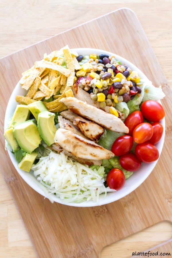 This flavorful salad is packed with the works: Tyson Grilled & Ready Chicken Fillets, Birds Eye Southwestern Protein Blend, pepper jack cheese, avocado, tortilla strips, tomatoes, and barbecue sauce. Quick, easy, and oh-so-delish!  www.alattefood.com
