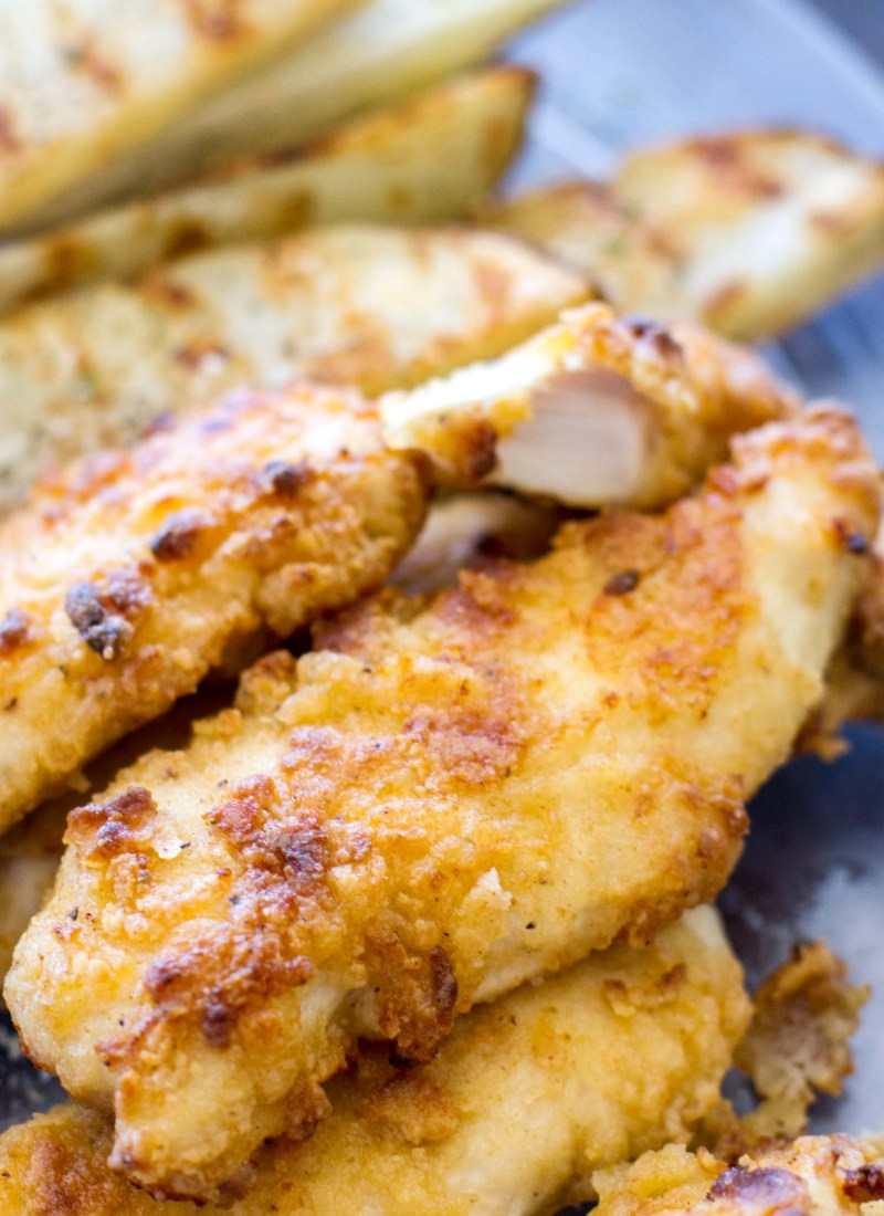 These Oven Baked Ranch Chicken Tenders are baked in the oven instead of fried. These chicken tenders are marinatedwith ranch dressing, giving this homemade chicken tender recipe incredible flavor! They're a total crowd pleaser.