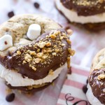 Toasted marshmallow ice cream is sandwiched between chocolate dipped s'mores chocolate chip cookies! | www.alattefood.com