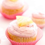 Lemon Cupcakes with Lemon Curd and Raspberry Buttercream: These light homemade lemon cupcakes are filled with tangy lemon curd and topped with rich homemade raspberry buttercream (raspberry frosting made with fresh raspberries!). These easy fluffy lemon cupcakes are sure to be a summer dessert favorite!