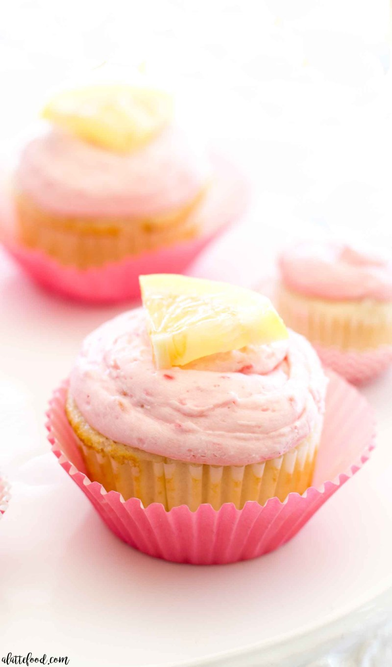 lemon raspberry cupcakes on cake stand