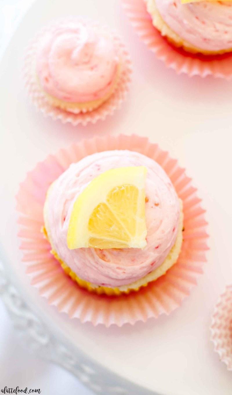 lemon slice on top of lemon raspberry cupcakes