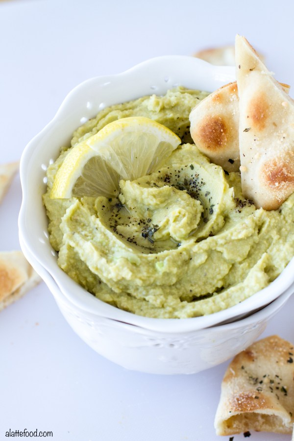 This homemade lemon pepper avocado hummus takes just a few ingredients and can be whipped up in minutes! Plus, these parmesan herb pita chips are seriously addicting. | www.alattefood.com