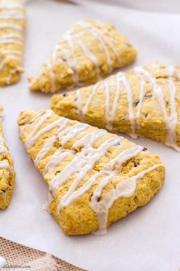 These pumpkin scones are packed with pumpkin flavor, pumpkin spices, and chocolate chips! Plus, it's topped with a cinnamon vanilla glaze! Yum.