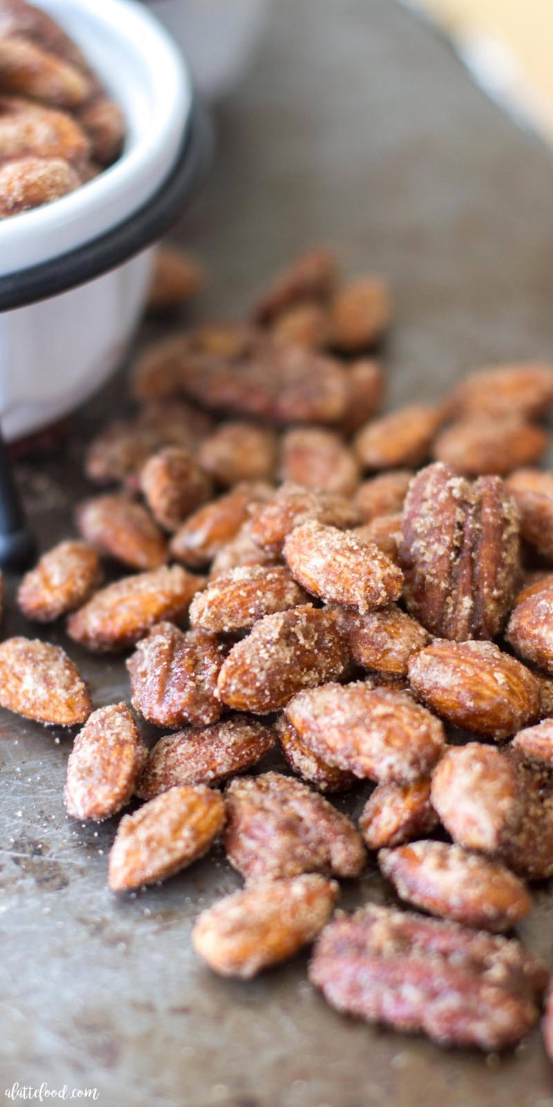 These sugared almonds and pecansare candied with a blend of pumpkin pie spice, white sugar, and brown sugar to make the most irresistible snack! Candied nuts are the ultimate fall snack, and this Pumpkin Spice Candied Nuts recipe is SO simple!