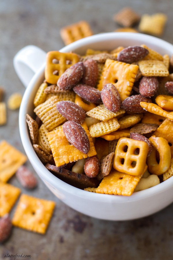 This easy appetizer snack mix is made with Blue Diamond Smokehouse Nuts, cheese crackers, pretzels, rice cereal, and seasonings to make an irresistible party mix!