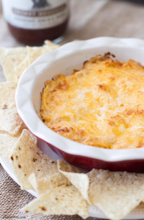 This cheesy barbecue chicken dip recipe is the perfect easy appetizer to bring to any tailgating party!