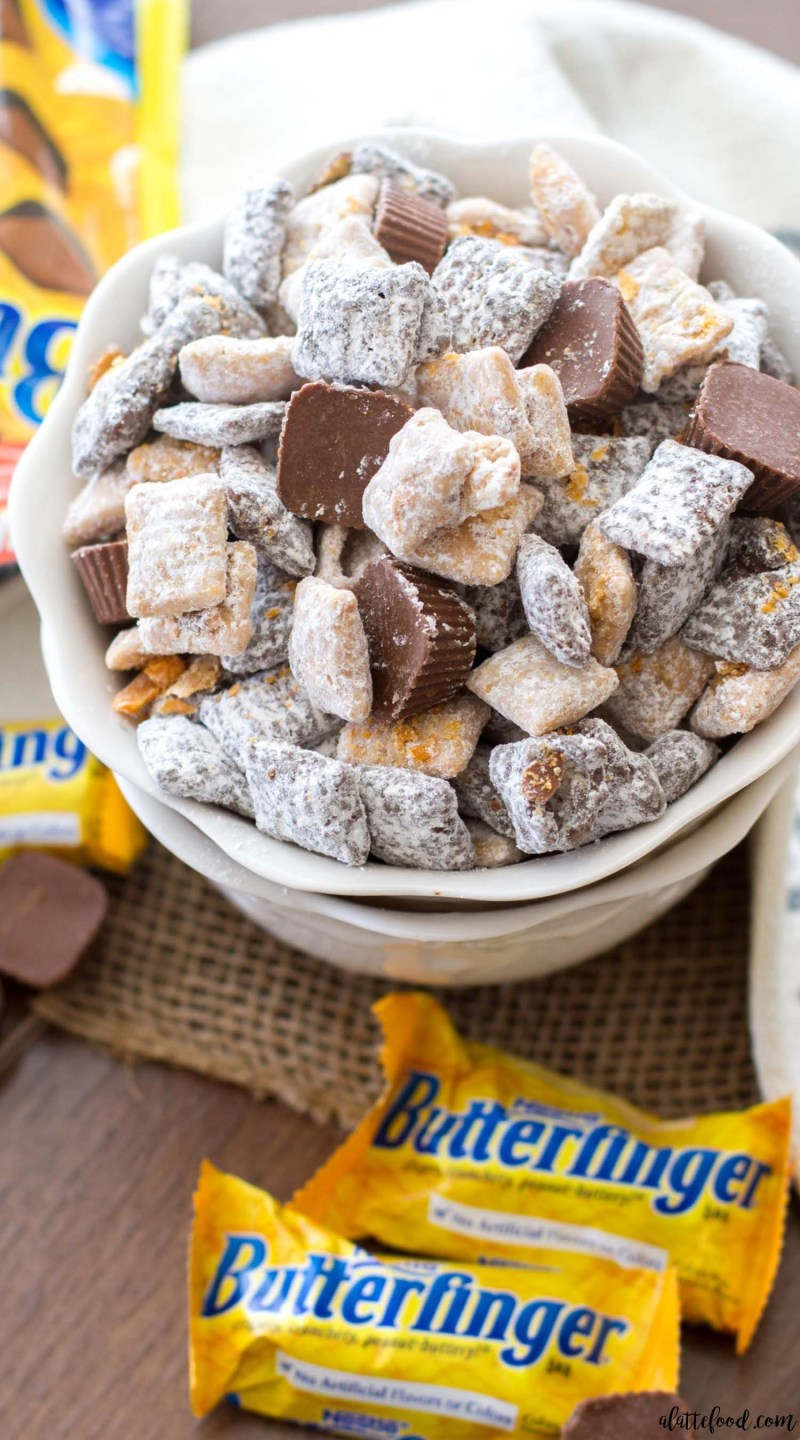 This easy puppy chow (muddy buddies) recipe is full of chocolate, peanut butter, and both ButterfingerFun-Size Candy Bars and ButterfingerPeanut Butter Cup Minis!This Butterfinger Puppy Chow is the best party snack around!