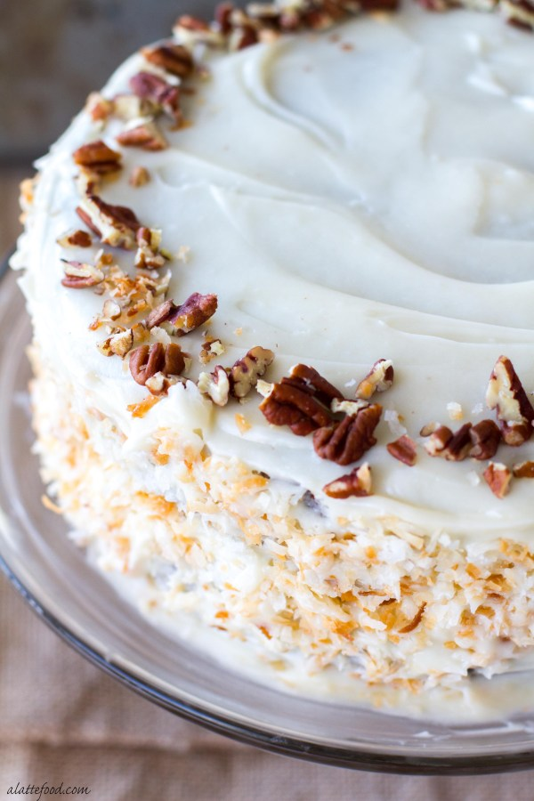 This moist carrot spice cake is the perfect Christmas dessert! With a thick cream cheese frosting, this cake is decadent and delicious!